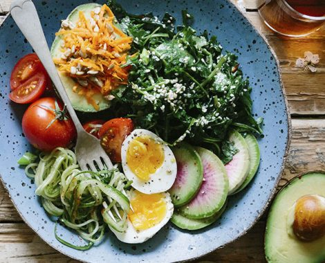 A salad in blue bowl in a rustic setting